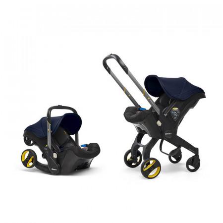 silla de coche convertible doona de simple parenting en el color royal blue